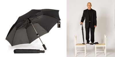 Unbreakable® Telescopic Umbrella U-202 supports a man
